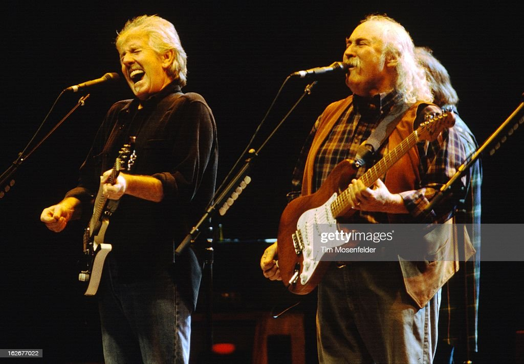 Graham Nash anf David Crosby of Crosby Stills Nash and Young perform at the San Jose Arena on February 4 2000 in San Jose California
