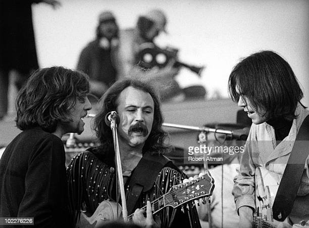 Graham Nash David Crosby and Neil Young of Cosby Stills Nash and Young perform onstage at The Altamont Speedway on December 6 1969 in Livermore...