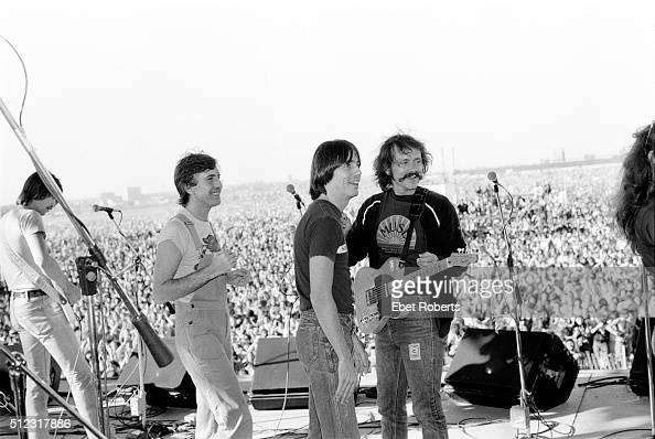 Graham Nash Jackson Browne and Jessie Colin Young of The Youngbloods performing at the No Nukes Muse Rally in Battery Park City in New York City on...