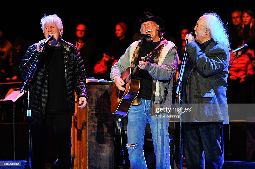 Graham Nash, Neil Young and David Crosby (L-R) perform on Day 2 of the 27th Annual Bridge School Benefit concert at Shoreline Amphitheatre on October 27, 2013 in Mountain View, California.
