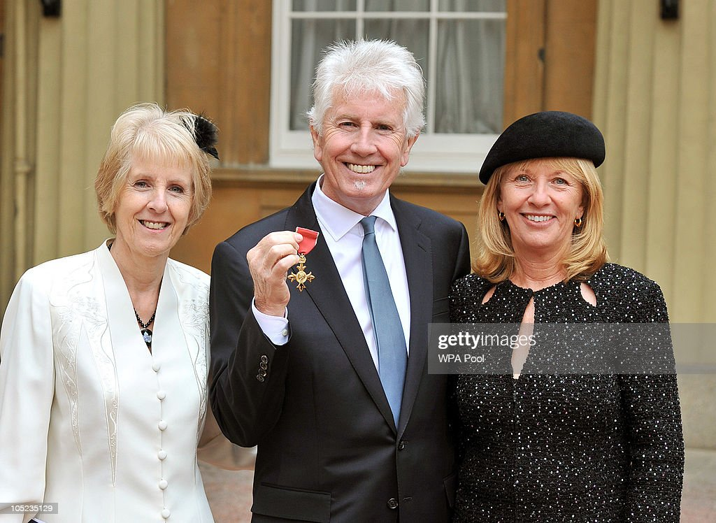 Graham Nash, one of the founder members of 1960s pop group The Hollies, and folk rock groups Crosby, Stills & Nash and Crosby, Stills, Nash & Young, poses with his with sister Elaine (L) and wife Susan and his OBE (Order of the British Empire) medal received from Queen Elizabeth II during the Royal Investiture ceremony at Buckingham Palace on October 13, 2010 in London, England.