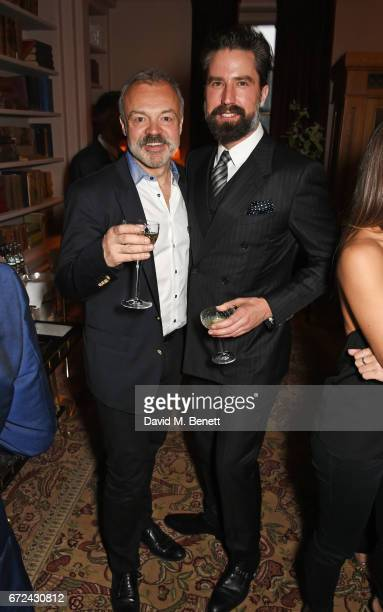 Graham Norton and Jack Guinness attend the NetaPorter Mr Porter preopening dinner cohosted by Jenny Dickinson and Jeremy Langmead in The Saloon at...