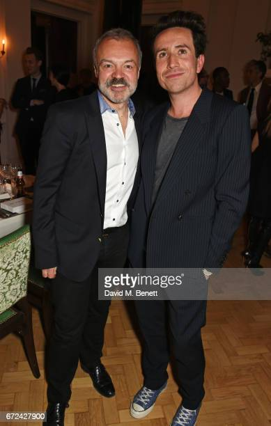 Graham Norton and Nick Grimshaw attend the NetaPorter Mr Porter preopening dinner cohosted by Jenny Dickinson and Jeremy Langmead in The Saloon at...