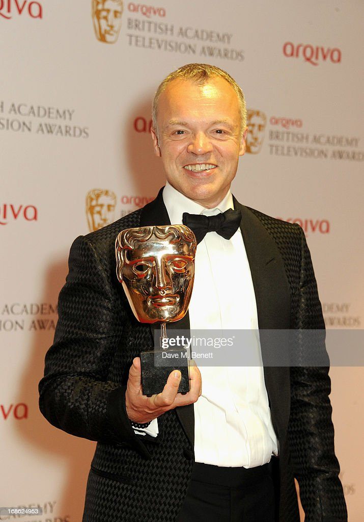 Graham Norton, host and winner of the award for Entertainment Programme, poses in the press room at the Arqiva British Academy Television Awards 2013 at the Royal Festival Hall on May 12, 2013 in London, England.