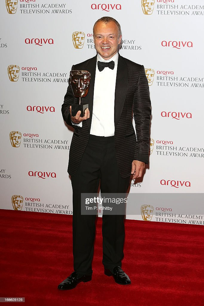 Graham Norton poses with his award for Best Entertainment Programme during the Arqiva British Academy Television Awards 2013 at the Royal Festival Hall on May 12, 2013 in London, England.