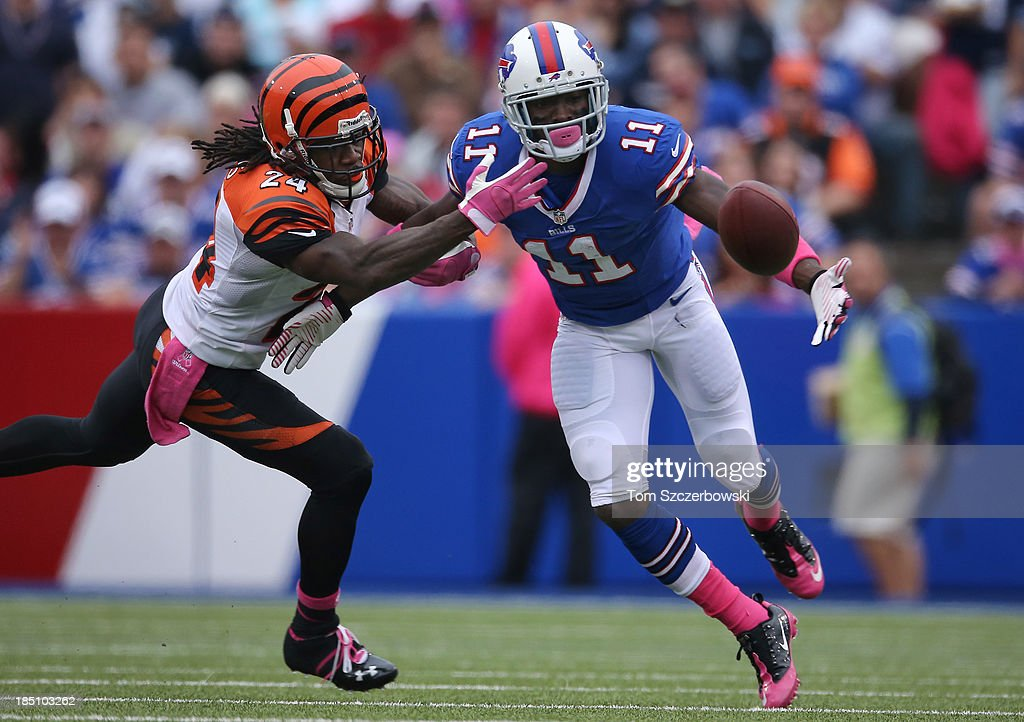T.J. Graham #11 of the Buffalo Bills cannot hold on to a pass during NFL game action as Adam Jones #24 of the Cincinnati Bengals defends at Ralph Wilson Stadium on October 13, 2013 in Orchard Park, New York.