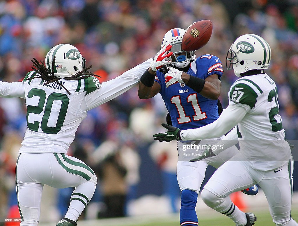 T.J. Graham #11 of the Buffalo Bills has a pass knocked away by Kyle Wilson #20 of the New York Jets at Ralph Wilson Stadium on December 30, 2012 in Orchard Park, New York. Buffalo defeated New York 28-9.