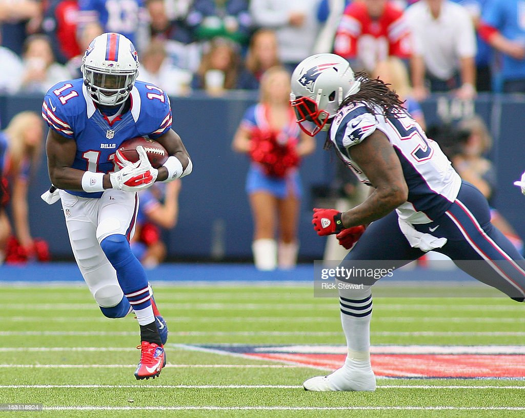 T.J. Graham #11 of the Buffalo Bills runs after a catch against <a gi-track='captionPersonalityLinkClicked' href=/galleries/search?phrase=Brandon+Spikes&family=editorial&specificpeople=2972710 ng-click='$event.stopPropagation()'>Brandon Spikes</a> #55 of the New England Patriots at Ralph Wilson Stadium on September 30, 2012 in Orchard Park, New York. New England won 52-28.