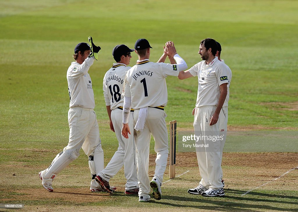 <a gi-track='captionPersonalityLinkClicked' href=/galleries/search?phrase=Graham+Onions&family=editorial&specificpeople=691130 ng-click='$event.stopPropagation()'>Graham Onions</a> (R) of Durham celebrates after bowling out Tony Palladino of Derbyshire during the LV County Championship match between Derbyshire and Durham at The County Ground on September 12, 2013 in Derby, England.