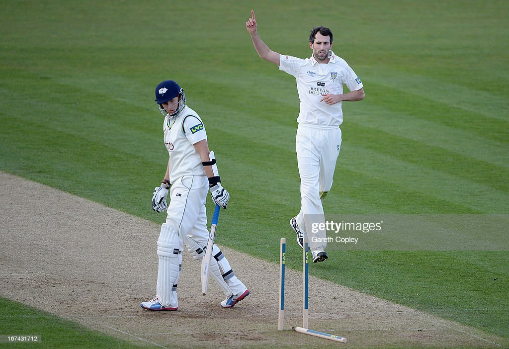 Graham Onions of Durham celebrates bowling Joe Root of Yorkshire during day two of the LV County Championship division one match between Durham and...