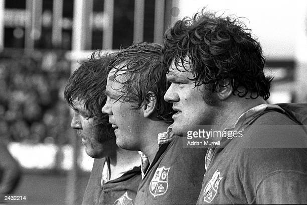 Graham Price Peter Wheeler and Fran Cotton of the British Lions look on during the British Lions tour 1977 in New Zealand