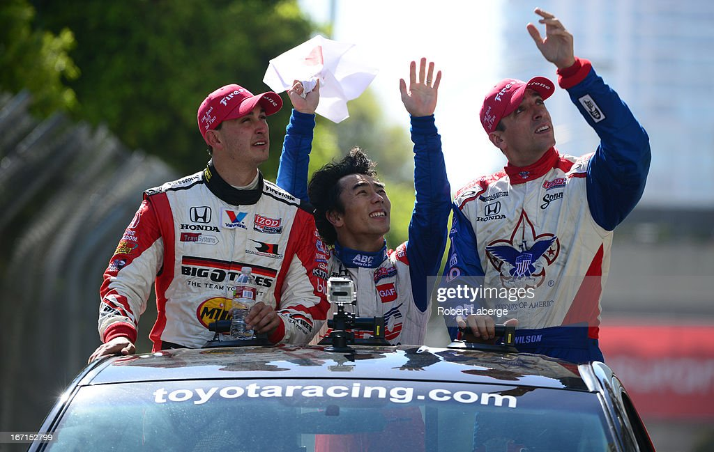 <a gi-track='captionPersonalityLinkClicked' href=/galleries/search?phrase=Graham+Rahal&family=editorial&specificpeople=709487 ng-click='$event.stopPropagation()'>Graham Rahal</a> driver of the #15 Midas Big O Tires Dallara Honda second place, <a gi-track='captionPersonalityLinkClicked' href=/galleries/search?phrase=Takuma+Sato&family=editorial&specificpeople=203006 ng-click='$event.stopPropagation()'>Takuma Sato</a> of Japan driver of the #14 ABC Supply A. J. Foyt Racing Dallara Honda winner, <a gi-track='captionPersonalityLinkClicked' href=/galleries/search?phrase=Justin+Wilson+-+Race+Car+Driver&family=editorial&specificpeople=11906287 ng-click='$event.stopPropagation()'>Justin Wilson</a> of England driver of the #19 Dale Coyne Racing Dallara Honda, third place do a parade lap after the IndyCar Series Toyota Grand Prix of Long Beach on April 21, 2013 on the streets of Long Beach, California.