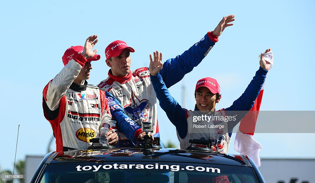 <a gi-track='captionPersonalityLinkClicked' href=/galleries/search?phrase=Graham+Rahal&family=editorial&specificpeople=709487 ng-click='$event.stopPropagation()'>Graham Rahal</a> driver of the #15 Midas Big O Tires Dallara Honda second place, <a gi-track='captionPersonalityLinkClicked' href=/galleries/search?phrase=Justin+Wilson+-+Race+Car+Driver&family=editorial&specificpeople=11906287 ng-click='$event.stopPropagation()'>Justin Wilson</a> of England driver of the #19 Dale Coyne Racing Dallara Honda, third place and <a gi-track='captionPersonalityLinkClicked' href=/galleries/search?phrase=Takuma+Sato&family=editorial&specificpeople=203006 ng-click='$event.stopPropagation()'>Takuma Sato</a> of Japan driver of the #14 ABC Supply A. J. Foyt Racing Dallara Honda do a parade lap after the IndyCar Series Toyota Grand Prix of Long Beach on April 21, 2013 on the streets of Long Beach, California.