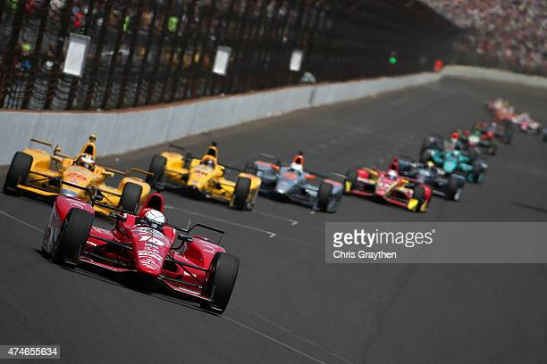 Graham Rahal driver of the Rahal Letterman Lanigan Racing Honda Dallara leads a pack of cars during the 99th running of the Indianapolis 500 mile...