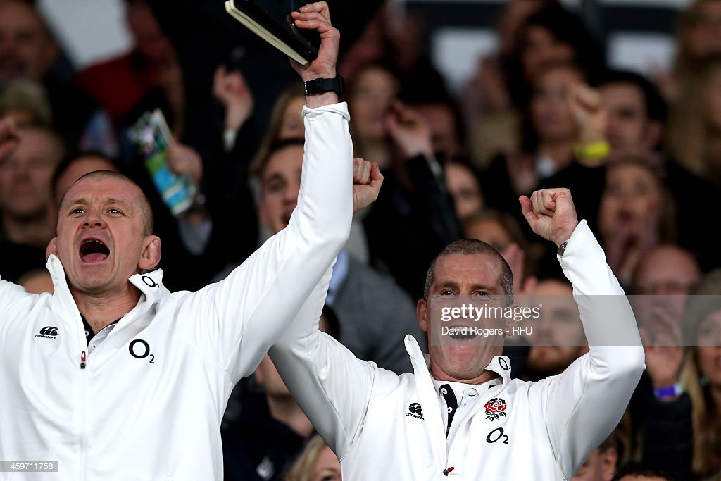Graham Rowntree the England forwards coach celebrates with Stuart Lancaster the head coach of England after winning the QBE international match...