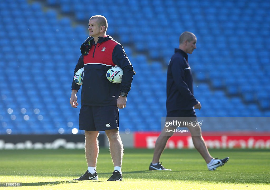 Graham Rowntree the England forwards coach looks on as Stuart Lancaster walks off the pitch during the England captain's run at the City of...