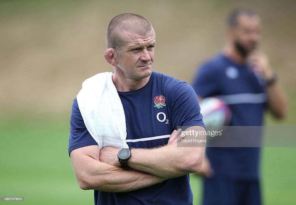 Graham Rowntree the England forwards coach looks on during the England training session at Pennyhill Park on August 11 2015 in Bagshot England