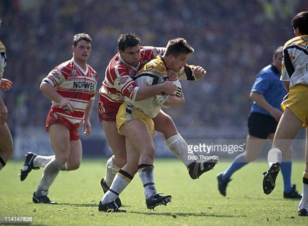 Graham Southernwood of Castleford is tackled by Kelvin Skerrett of Wigan during the Silk Cut Rugby League Challenge Cup Final at Wembley Stadium...