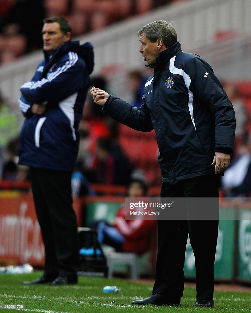 Graham Turner, manager of Shrewsbury Town gives out instructions, as <a gi-track='captionPersonalityLinkClicked' href=/galleries/search?phrase=Tony+Mowbray&family=editorial&specificpeople=3470107 ng-click='$event.stopPropagation()'>Tony Mowbray</a>, manager of Middlesbrough looks on during the FA Cup Third Round match between Middlesbrough and Shrewsbury Town at Riverside Stadium on January 7, 2012 in Middlesbrough, England.