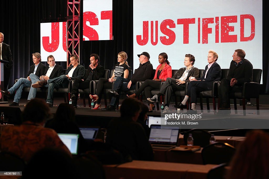 Graham Yost, Executive Producer, Michael Dinner, Executive Producer, actors Timothy Olyphant, Walton Goggins, Joelle Carter, Nick Searcy, Erica Tazel, Jacob Pitts, Jere Burns and Michael Rapaport of the television show 'Justified' onstage during the FX portion of the 2014 Television Critics Association Press Tour at the Langham Hotel on January 14, 2014 in Pasadena, California.