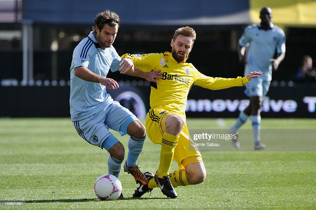 Graham Zusi #8 of Sporting Kansas City and <a gi-track='captionPersonalityLinkClicked' href=/galleries/search?phrase=Eddie+Gaven&family=editorial&specificpeople=2297558 ng-click='$event.stopPropagation()'>Eddie Gaven</a> #12 of the Columbus Crew battle for control of the ball on October 7, 2012 at Crew Stadium in Columbus, Ohio.