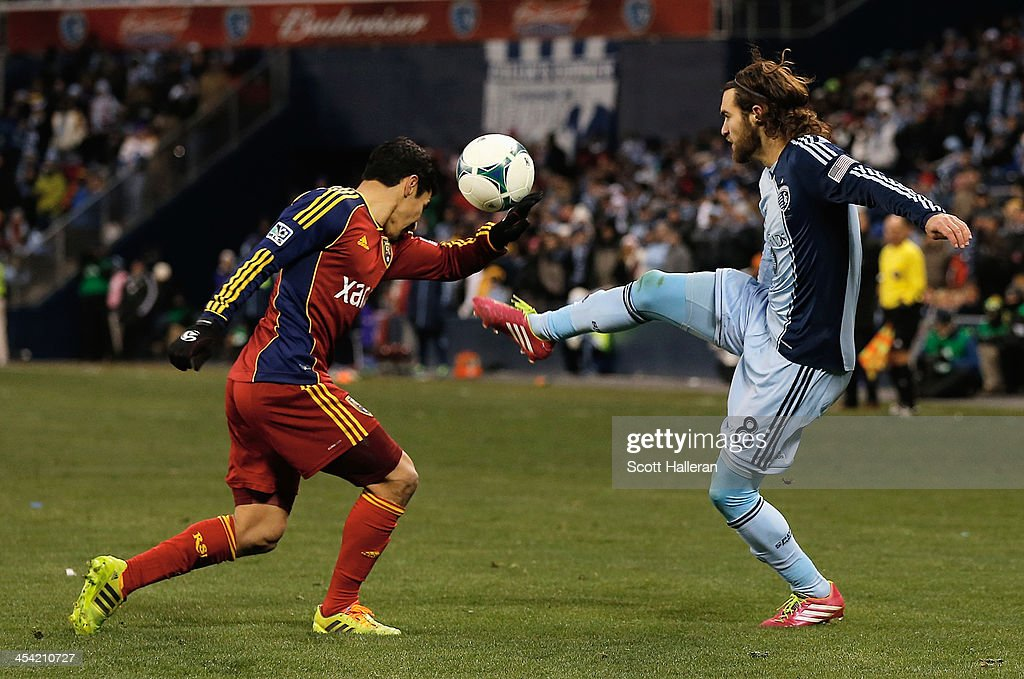Graham Zusi #8 of Sporting KC works the ball against Tony Beltran #2 of Real Salt Lake in the second half of the 2013 MLS Cup at Sporting Park on December 7, 2013 in Kansas City, Kansas.