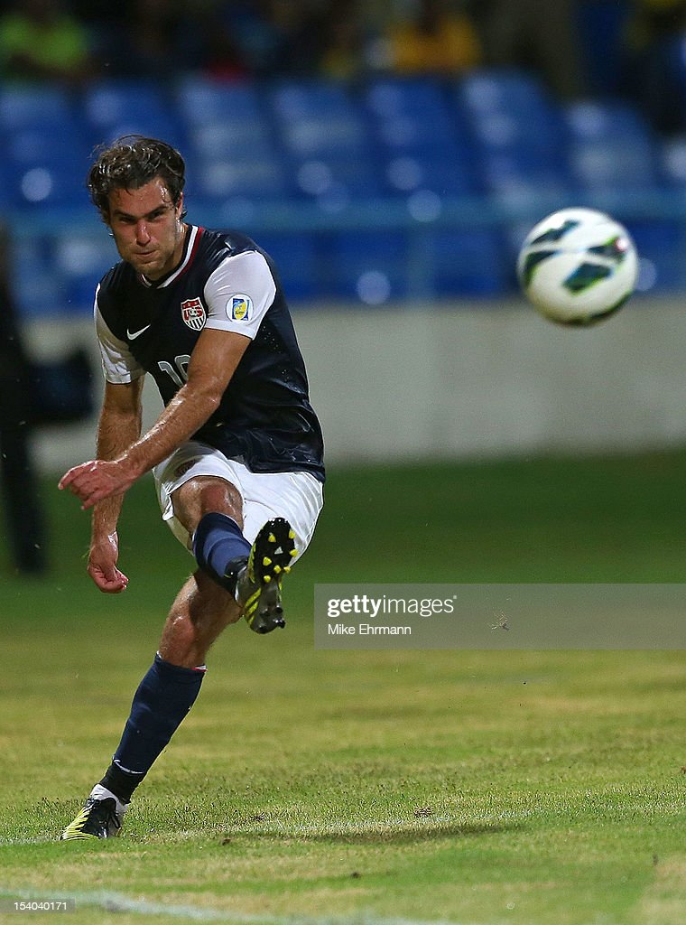 Graham Zusi #19 of the United States makes a corner kick during a World Cup Qualifying game against Antigua and Barbuda at Sir Vivian Richards Stadium on October 12, 2012 in Antigua, Antigua and Barbuda.