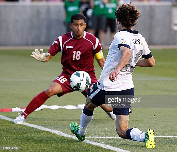 Graham Zusi of the United States takes a shot on goal against goalie Noel Valladares of Honduras during the second half of a World Cup qualifying...