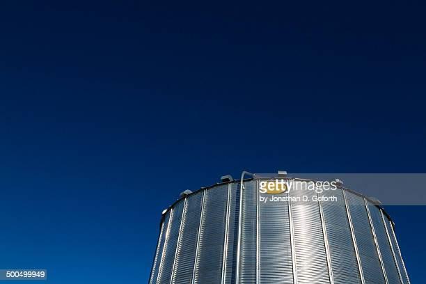 Grain bin with blue sky