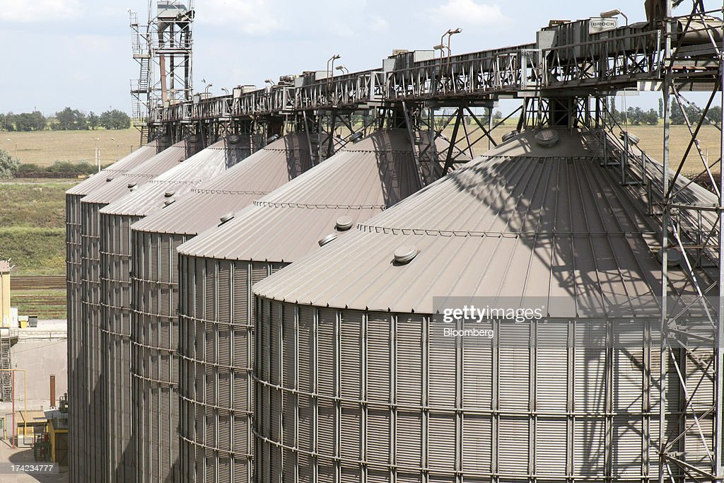 Grain silos stand on the dockside in Yuzhny port, operated by TIS Group, near Odessa, Ukraine, on Friday, July 19, 2013. Ukraine wants to cut current-account deficit to 3%-4% of GDP in medium term, central bank official Serhiy Nikolaychuk tells reporters in Kiev. Photographer: Vincent Mundy/Bloomberg via Getty Images