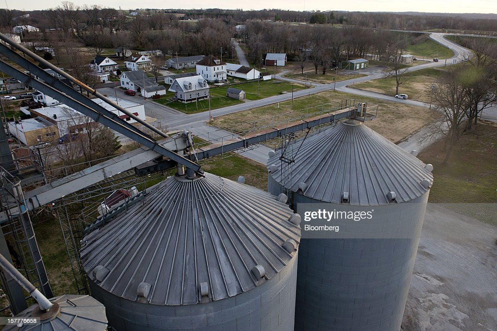 Grain storage bins stand at Gateway FS in Evansville, Illinois, U.S., on Wednesday, Dec. 5, 2012. U.S. farmers, facing aftershocks of the worst drought in 50 years, are improvising alternative plans for corn, soybeans and other grains that won't be moving to world markets as the Mississippi River dries up. Photographer: Daniel Acker/Bloomberg via Getty Images