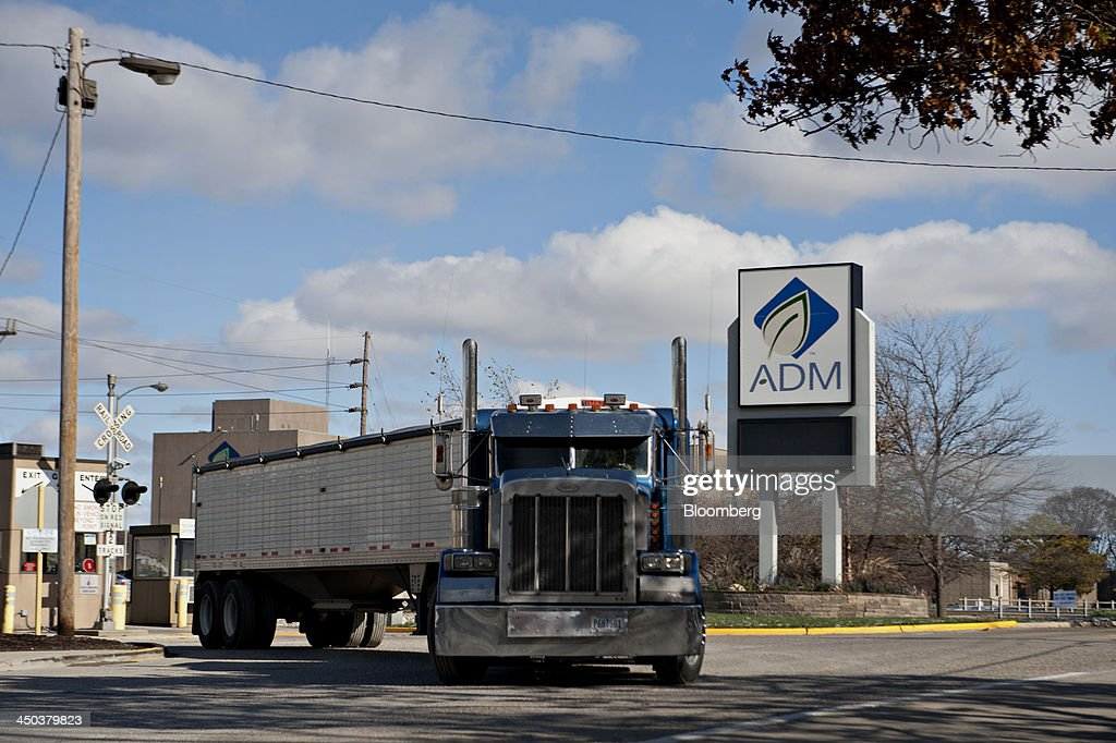 A grain truck exits the campus of the Archer-Daniels-Midland Co. (ADM) headquarters and the Decatur Corn Plant in Decatur, Illinois, U.S., on Tuesday, Nov. 12, 2013. Archer-Daniels-Midland Co. procures, transports, stores, processes, and merchandises agricultural commodities and products as well as processes oilseeds, corn, milo, oats, barley, peanuts, and wheat. Photographer: Daniel Acker/Bloomberg via Getty Images
