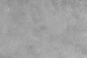 This raster texture image features stale texture imagery.  It is a combination of gray surface incorporating grainy textures and rough stains .  The image displays distressed, aged material surface im