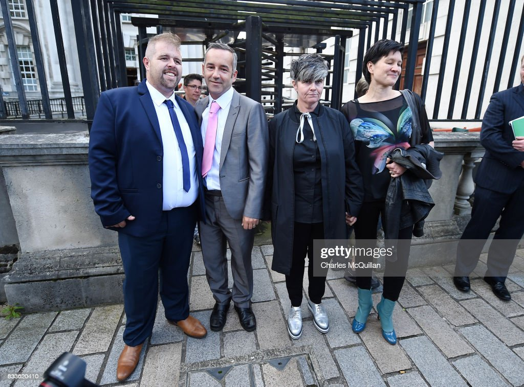 Grainne Close (2nd R) and Shannon Sickles (R) alongside Henry Edmond Kane (L) and Christopher Patrick Flanagan (2nd L) at Belfast High Court after the ruling on whether to allow same-sex marriage in Northern Ireland on August 17, 2017 in Belfast, Northern Ireland. The judge dismissed both cases. Same-sex marriage is recognised in the rest of the United Kingdom but not in Northern Ireland were the largest political party, the DUP has blocked proposed legislation. Shannon Sickles and Grainne Close, the first women to have a civil partnership in the UK and Henry Edmond Kane and Christopher Patrick Flanagan were challenging the NI Assembly's repeated refusal to legislate for same sex marriage.