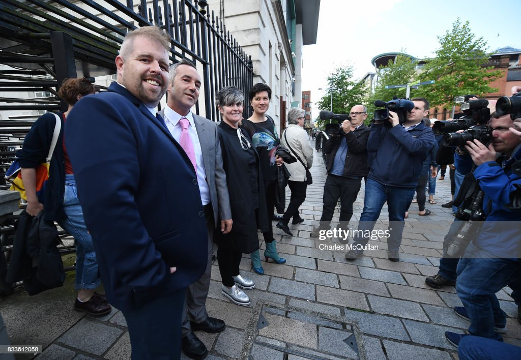 Grainne Close (2nd R) and Shannon Sickles (R) alongside Henry Edmond Kane (2nd L) and Christopher Patrick Flanagan (L) at Belfast High Court speak to the media after the ruling on whether to allow same-sex marriage in Northern Ireland on August 17, 2017 in Belfast, Northern Ireland. The judge dismissed both cases. Same-sex marriage is recognised in the rest of the United Kingdom but not in Northern Ireland were the largest political party, the DUP has blocked proposed legislation. Shannon Sickles and Grainne Close, the first women to have a civil partnership in the UK and Henry Edmond Kane and Christopher Patrick Flanagan were challenging the NI Assembly's repeated refusal to legislate for same sex marriage.