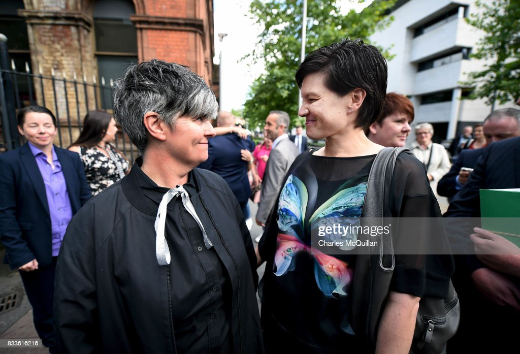 Grainne Close (L) and Shannon Sickles (R) smile at one another after losing their case for recognition of same-sex marriage in Northern Ireland on August 17, 2017 in Belfast, Northern Ireland. The judge dismissed both cases before the court. Same-sex marriage is recognised in the rest of the United Kingdom but not in Northern Ireland were the largest political party, the DUP has blocked proposed legislation. Shannon Sickles and Grainne Close, the first women to have a civil partnership in the UK and Henry Edmond Kane and Christopher Patrick Flanagan were challenging the NI Assembly's repeated refusal to legislate for same sex marriage.