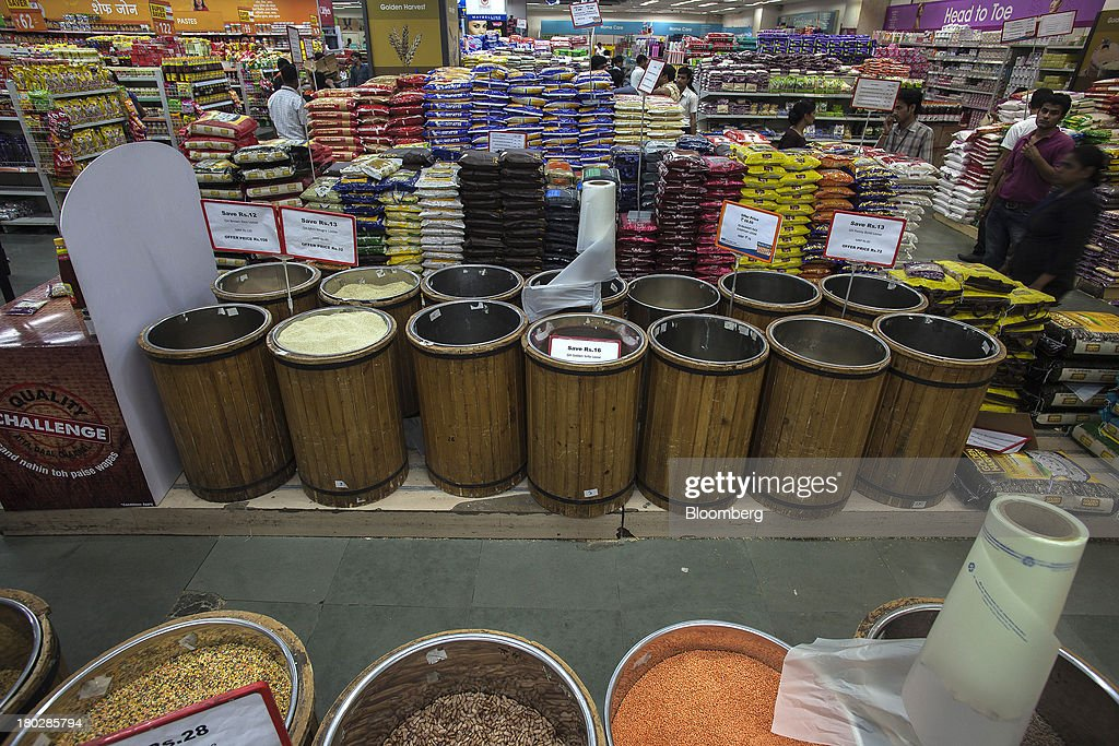 Grains and pulses are displayed for sale in the Big Bazaar Hypermarket store in Noida, India, on Monday, Sept. 9, 2013. Indias rupee fell, snapping the biggest four-day surge in 40 years, on concern slowing growth will deter inflows needed to reduce the current-account deficit. Photographer: Prashanth Vishwanathan/Bloomberg via Getty Images