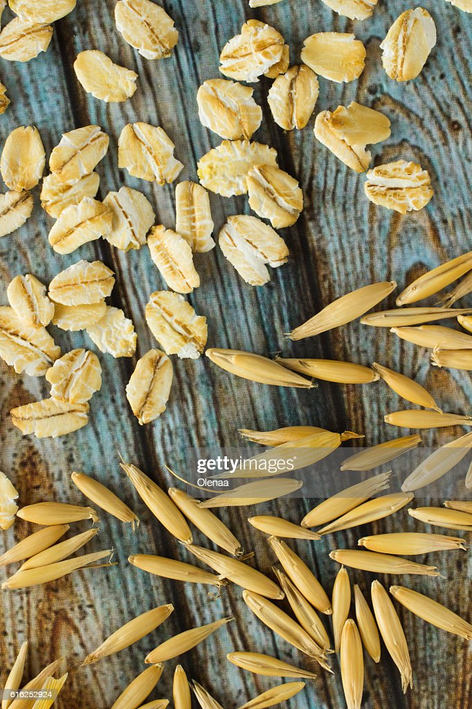 Grains of oats and oatmeal. Top view : Stock Photo