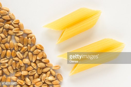 Grains of wheat and pasta in the shape tubes : Stock Photo