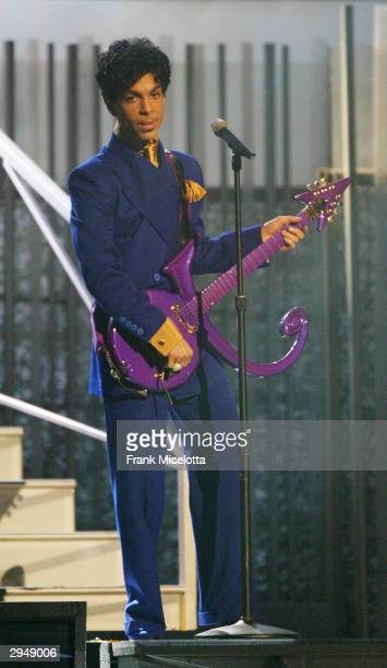 Grammy and Oscarwinning recording artist Prince performs the song 'Purple Rain' at the 46th Annual Grammy Awards held at the Staples Center on...