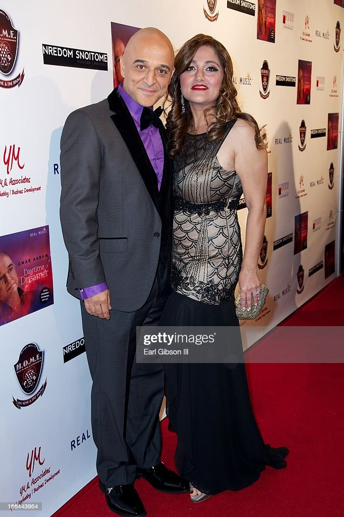 Grammy Award Winner Omar Akram and his wife Merry Akram attend his album release party at House of Music & Entertainment on October 30, 2013 in Beverly Hills, California.