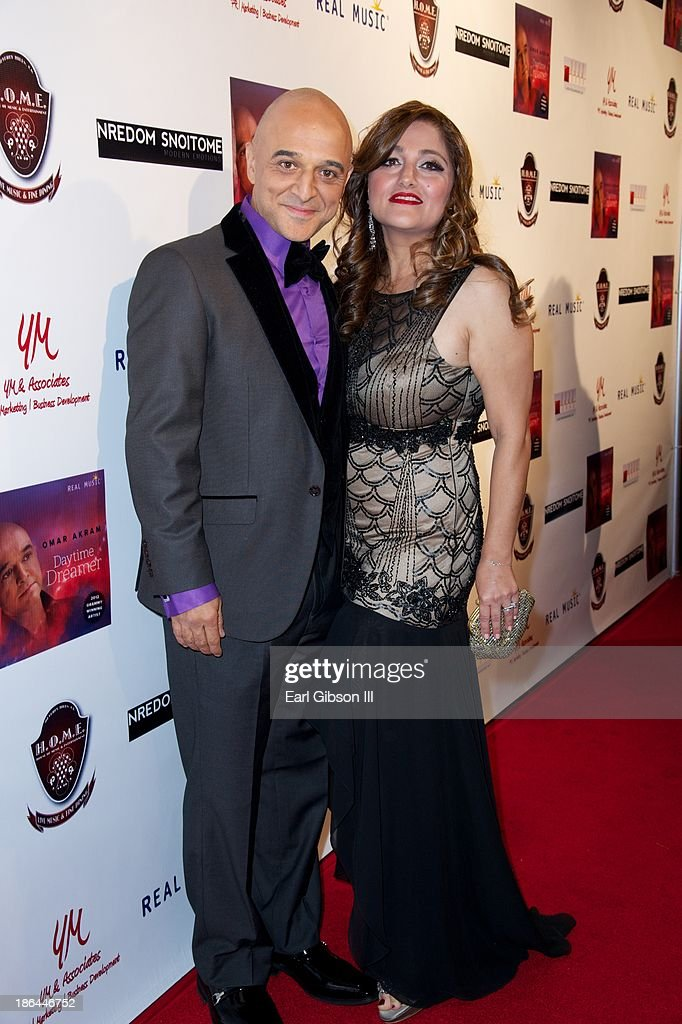 Grammy Award Winner <a gi-track='captionPersonalityLinkClicked' href=/galleries/search?phrase=Omar+Akram&family=editorial&specificpeople=10214793 ng-click='$event.stopPropagation()'>Omar Akram</a> and his wife Merry Akram attend his album release party at House of Music & Entertainment on October 30, 2013 in Beverly Hills, California.