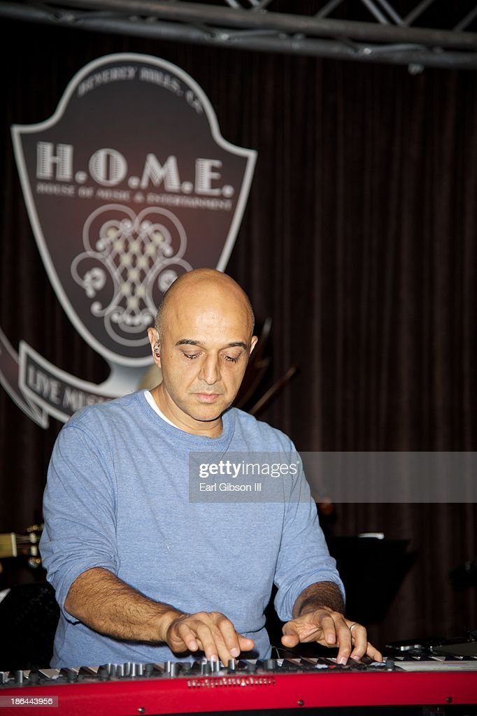 Grammy Award Winner <a gi-track='captionPersonalityLinkClicked' href=/galleries/search?phrase=Omar+Akram&family=editorial&specificpeople=10214793 ng-click='$event.stopPropagation()'>Omar Akram</a> practices for this album release party at House of Music & Entertainment on October 30, 2013 in Beverly Hills, California.