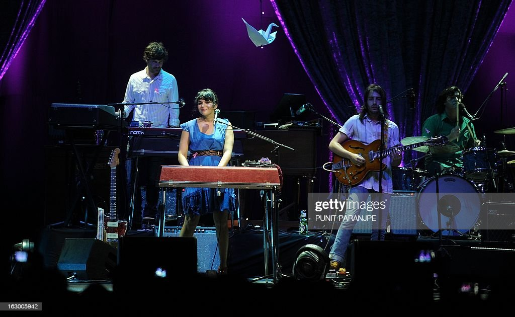 Grammy award winner singer Norah Jones (C) performs during her concert at A Summer's Day festival in Mumbai on March 3, 2013. Jones, who is the daughter of legendary Indian sitar player, the late Ravi Shankar, performed for the first time in the country.
