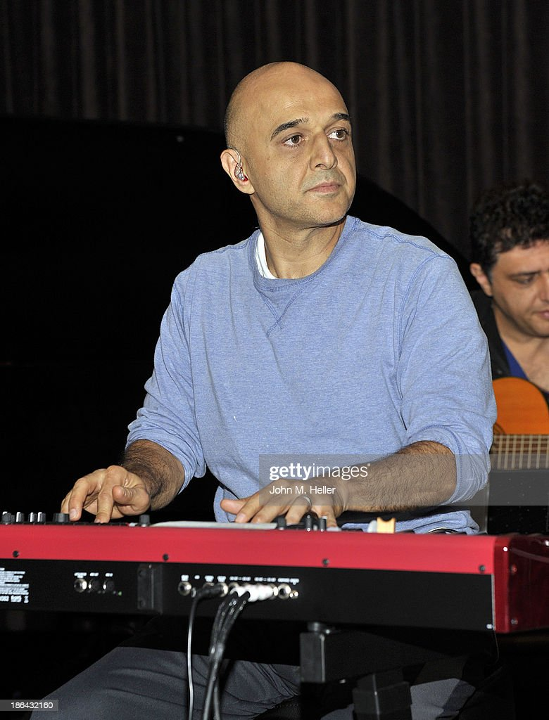 Grammy Award Winniing singer <a gi-track='captionPersonalityLinkClicked' href=/galleries/search?phrase=Omar+Akram&family=editorial&specificpeople=10214793 ng-click='$event.stopPropagation()'>Omar Akram</a> reherses at his 2013 album release party for 'Daytime Dreamer' at the House of Music & Entertainment on October 30, 2013 in Beverly Hills, California.