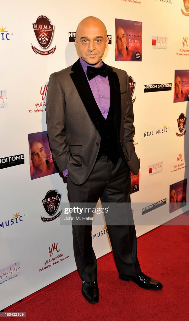 Grammy Award Winning singer <a gi-track='captionPersonalityLinkClicked' href=/galleries/search?phrase=Omar+Akram&family=editorial&specificpeople=10214793 ng-click='$event.stopPropagation()'>Omar Akram</a> attends his 2013 album release party for 'Daytime Dreamer' at the House of Music & Entertainment on October 30, 2013 in Beverly Hills, California.