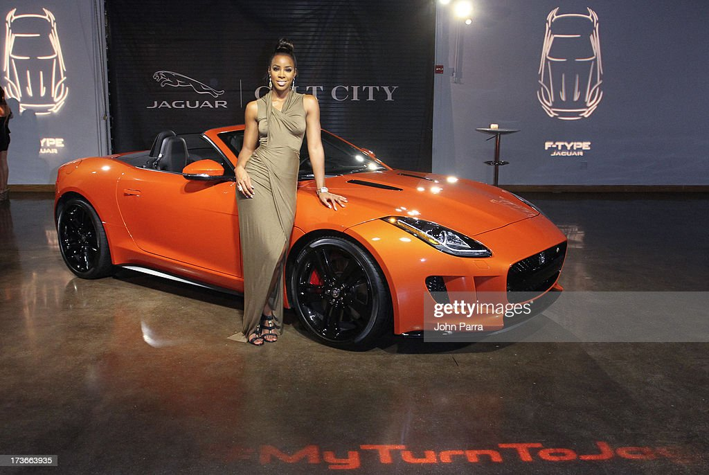 Grammy Award-winning artist Kelly Rowland with the all-new F-TYPE at the Jaguar ang GiltCityeventto celebratethe#MyTurnToJag social media contest at Soho Studios on July 15, 2013 in Miami, Florida.