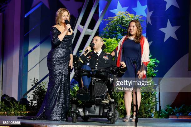 Grammy Awardwinning classical music artist Renee Fleming rehearses with Army Capt Luis Avila and vocal coach Rebecca Vaudreuili at PBS' 2017 National...