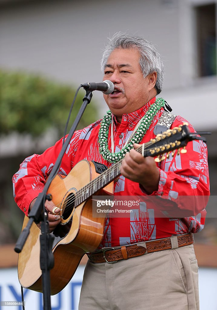 Grammy Award-winning Hawaiian musician George Kahumoku Jr. performs before the first round of the Hyundai Tournament of Champions at the Plantation Course on January 4, 2013 in Kapalua, Hawaii.