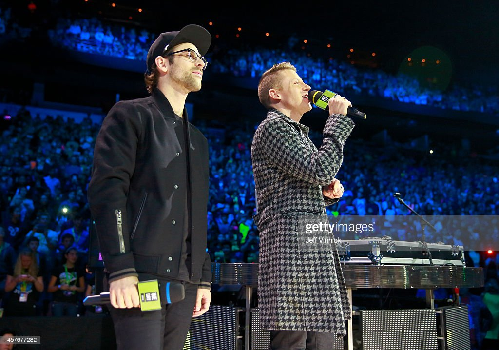 Grammy¨ Awardwinning hip hop artists Macklemore and Ryan Lewis speak onstage at We Day at Rogers Arena on October 22 2014 in Vancouver British...